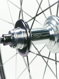The hub axle endcaps are threaded and held in place with small set screws. To adjust or disassemble, it's as simple as loosening the set screw and turning the end cap. | Michael Robson, michaelrobson.com