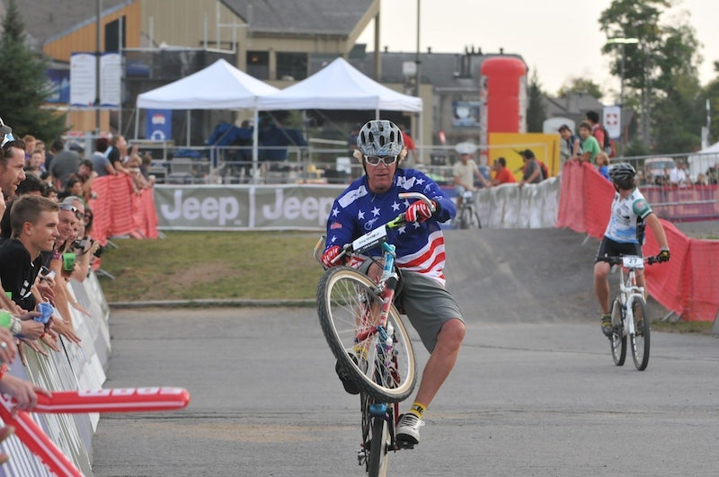 Legendary roostmaster Greg Herbold still rides a fine wheelie, 20 years after taking the first downhill title. Tom Moran