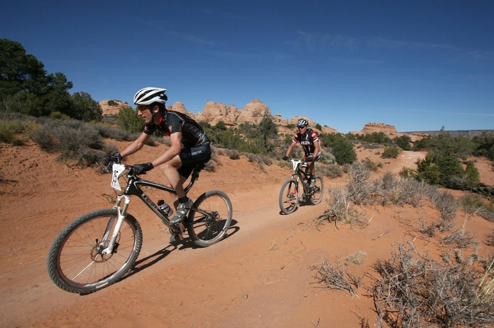 Kelly Magelky, who finished second overall in the men's solo field at the 2009 24-Hours of Moab, leads Josh Toatado, who was the eventual overall solo winner, early in the day. Photo by Garrett Geer