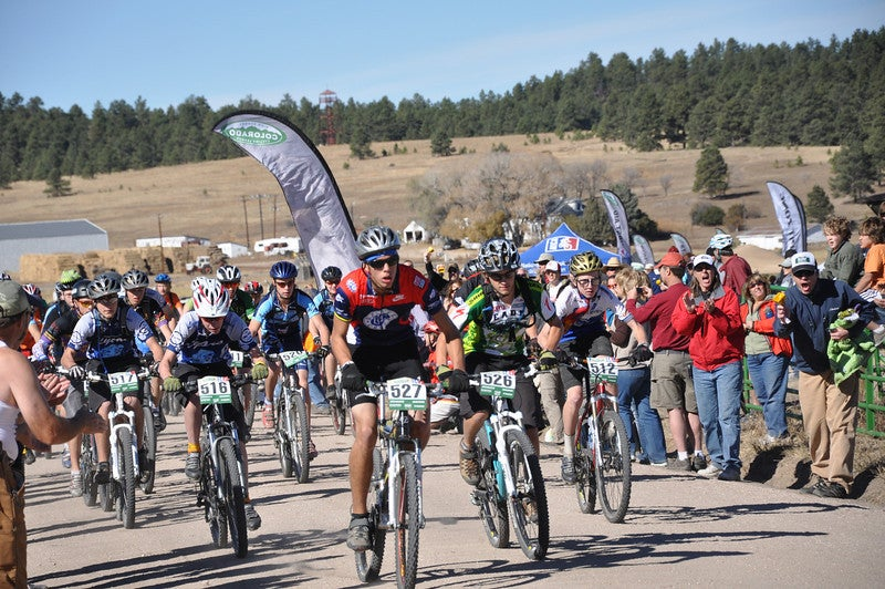 ophomore boys sprint off the start line with Caleb Krueger, Vail Valley Composite in the lead.