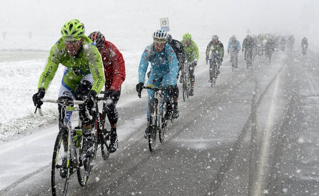 Cycling reverts to its purest form at weather-plagued Milano-Sanremo