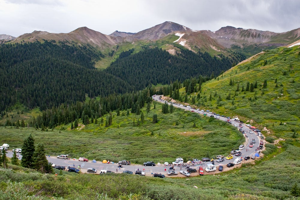 Photo of a cycling race going through a windy mountain road