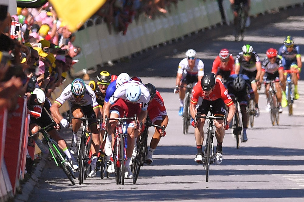 Tour de France: Fernando Gaviria takes first stage as Chris Froome crashes