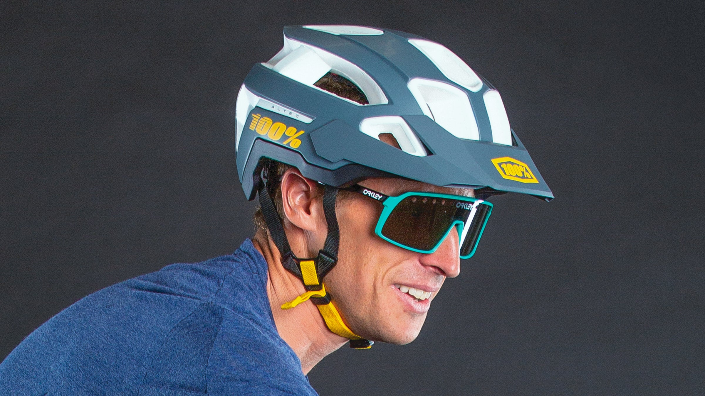 Close-up of man wearing cycling helmet and glasses