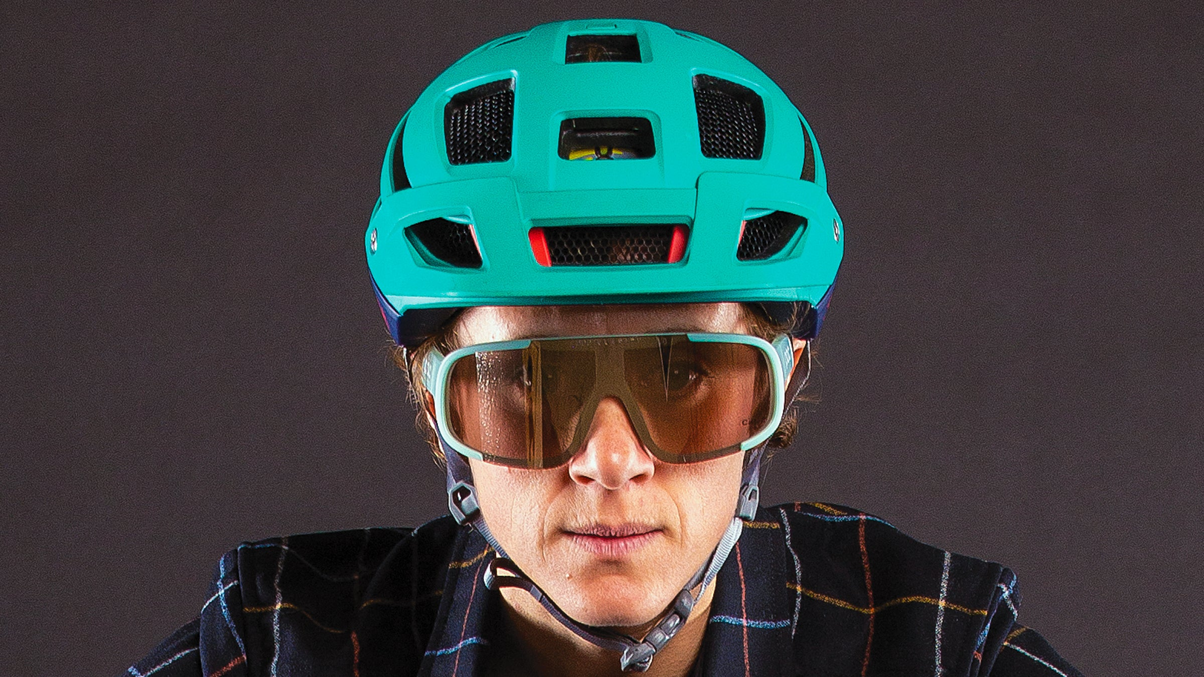 Close-up of woman wearing cycling helmet and sunglasses