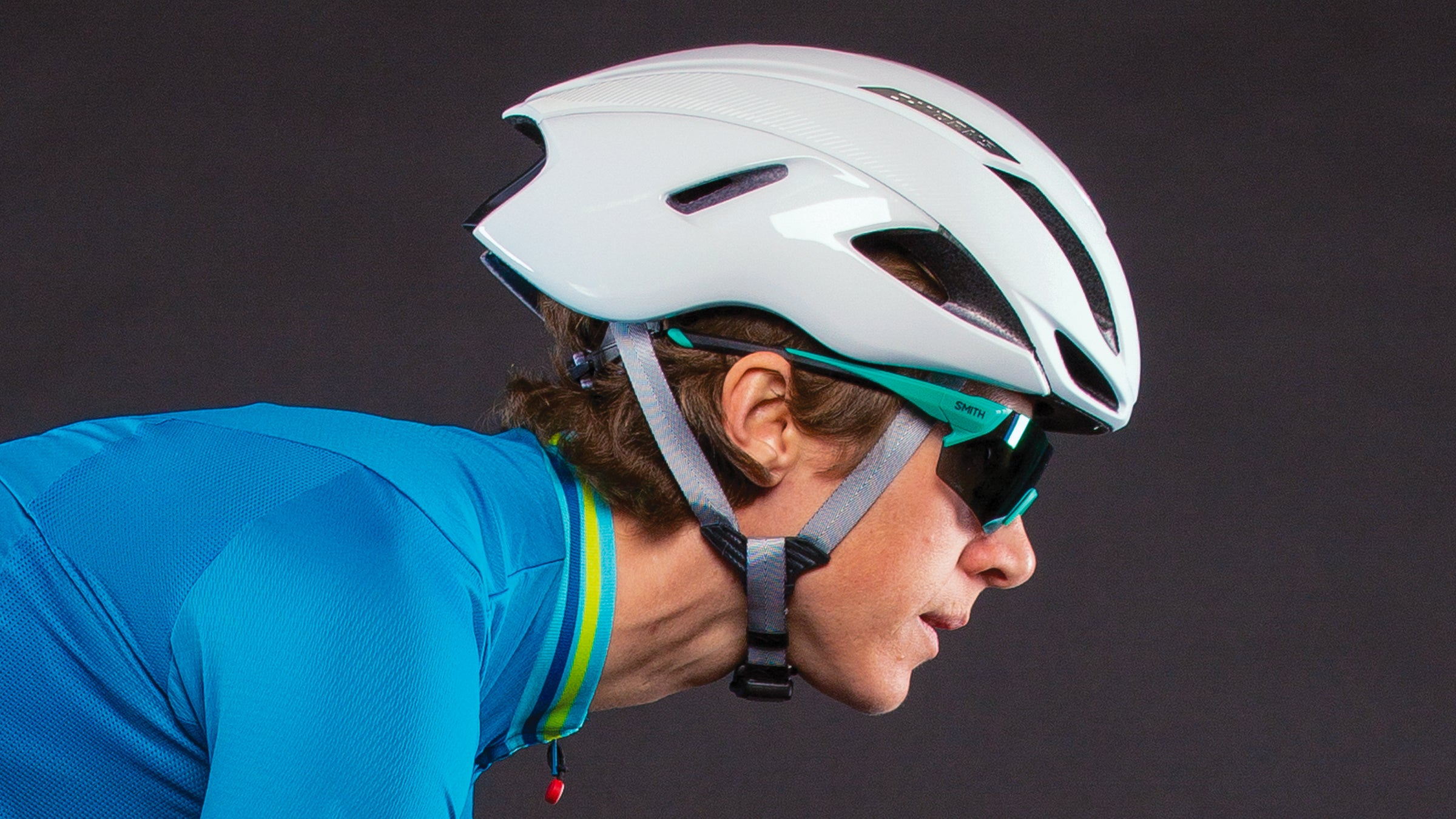 Close-up of a woman's profile wearing cycling helmet and sunglasses