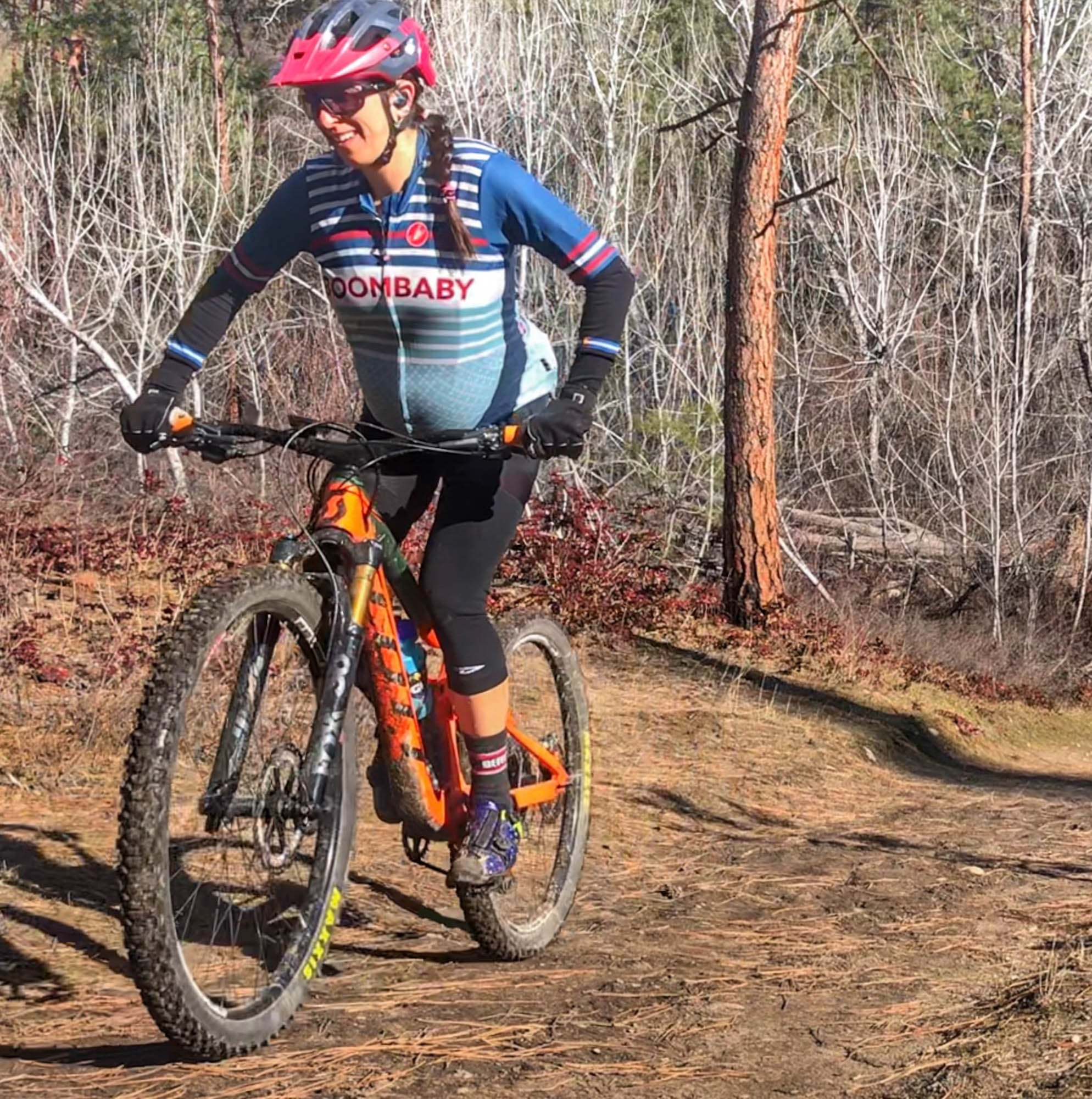Sonya Looney riding her mountain bike while pregnant