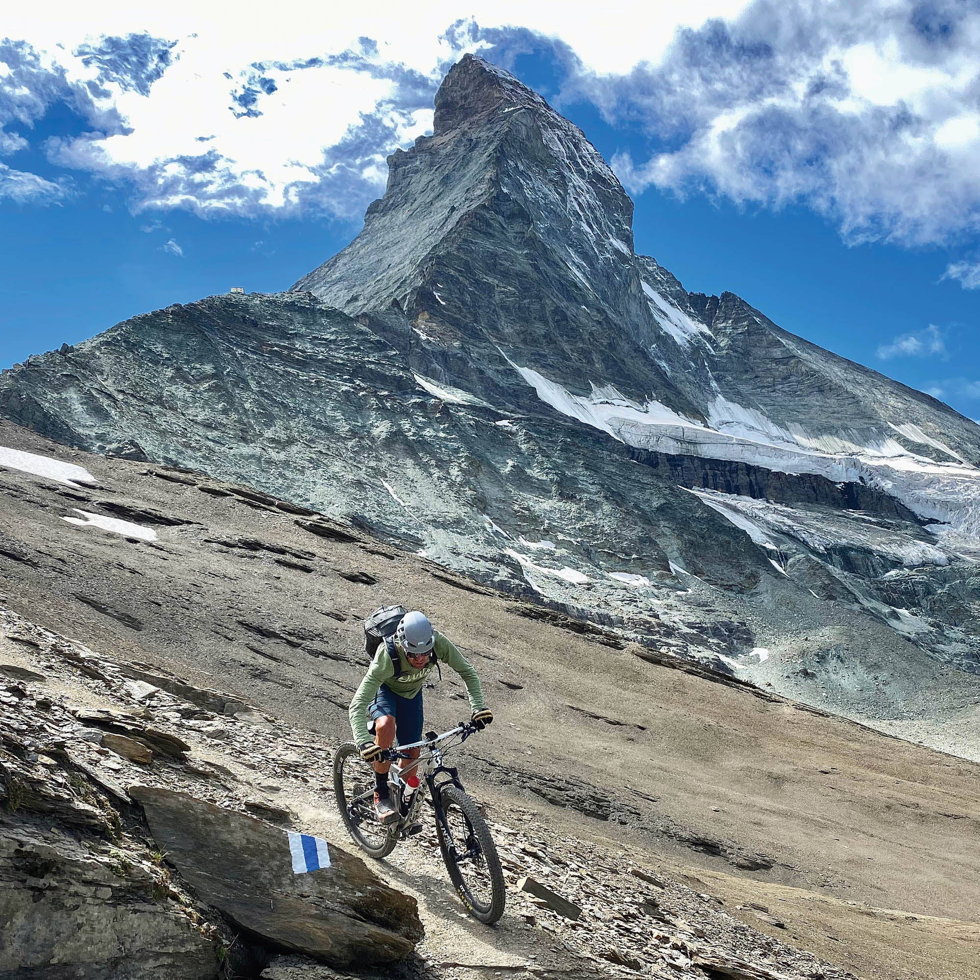 Frischi riding down a slope in front of the Matterhorn