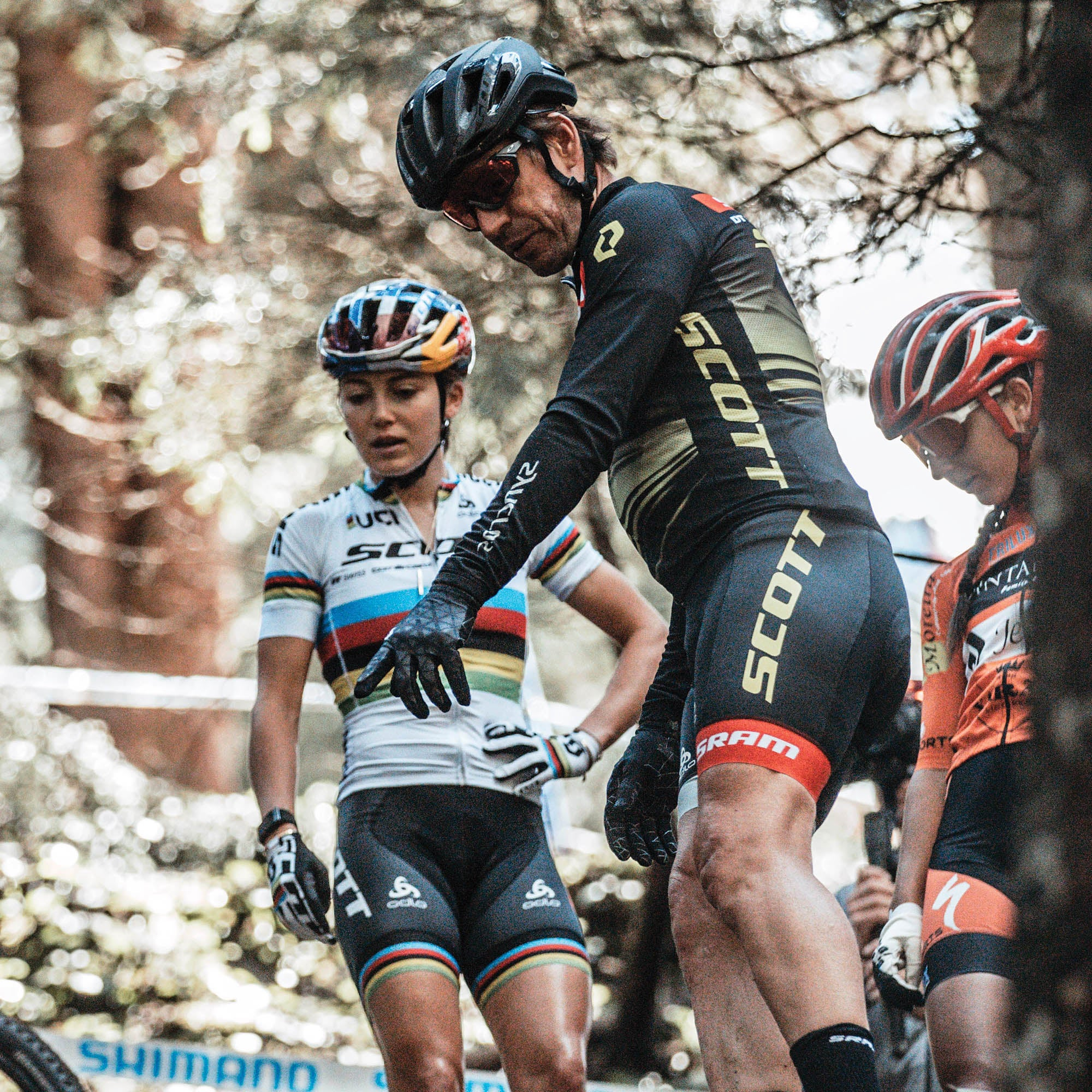Kate Courtney and Frischi looking down an mtb jump